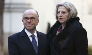 French Interior Minister Bernard Cazeneuve, left, welcomes Britain's Interior Minister Theresa May before the start of an international meeting aimed at fighting terrorism, in Paris, France, Sunday, Jan. 11, 2015. A rally of defiance and sorrow, protected by an unparalleled level of security, on Sunday will honor the 17 victims of three days of bloodshed in Paris that left France on alert for more violence. (AP Photo/Peter Dejong)/PAR115/987867890141/1501111213