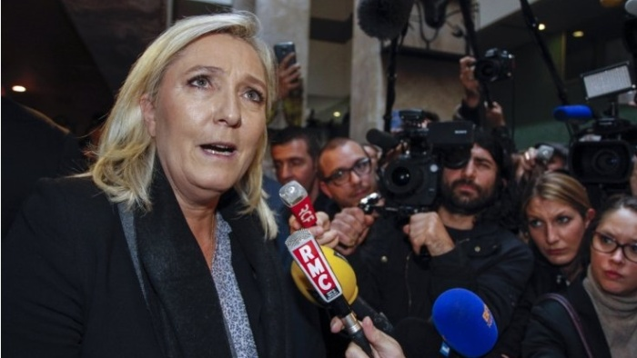 Marine Le Pen in court on racial hatredcharges